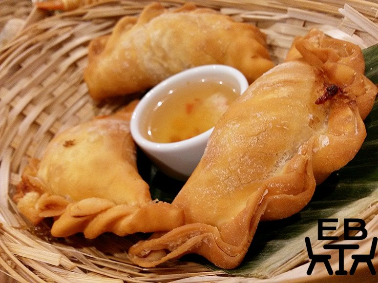 Whole crispy dumplings with a fish sauce to dip in.