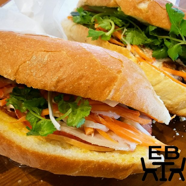 The classic triple pork and the lemongrass pork banh mis. Crumbs already falling.
