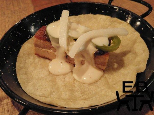 Sin Vida Panceta de Cerdo taco. Pork belly, mole negro, jicama, pickled jalapeno, garlic crema.