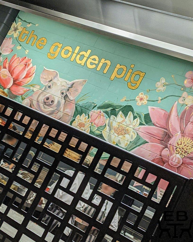 golden pig mural